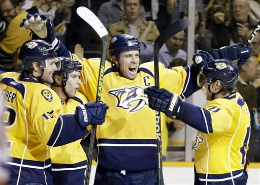 Nashville Predators forward Zach Boychuk, second from left, celebrates with Mike Fisher, left, Shea Weber, center, and Martin Erat, of the Czech Republic, after Boychuk scored against the Edmonton Oilers in the second period of an NHL hockey game Friday, March 8, 2013, in Nashville, Tenn. (AP Photo/Mark Humphrey)