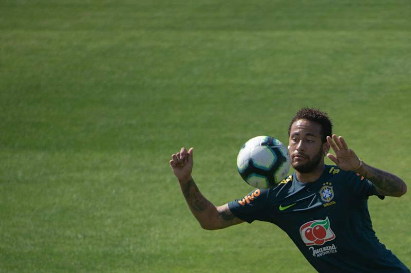 Brazil's footballer Neymar takes part in a training session of the national team at the Granja Comary sport complex in Teresopolis, Brazil, on June 1, 2019 ahead of the Copa America football tournament. (Photo by Mauro PIMENTEL / AFP) (Photo credit should read MAURO PIMENTEL/AFP/Getty Images)