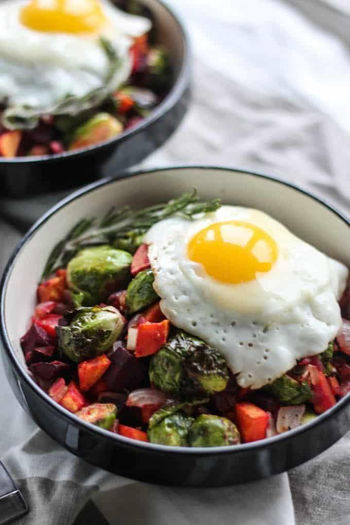 """<p>Brussels sprouts absolutely belong at your breakfast table. Roasted alongside sweet potatoes and beets, then topped with an egg, you'll start craving them in the morning, too.</p><p><a href=""""https://www.destinationdelish.com/rosemary-roasted-vegetable-breakfast-bowls/"""" rel=""""nofollow noopener"""" target=""""_blank"""" data-ylk=""""slk:Get the recipe from Destination Delish »"""" class=""""link rapid-noclick-resp""""><strong><em>Get the recipe from Destination Delish »</em></strong> </a></p>"""