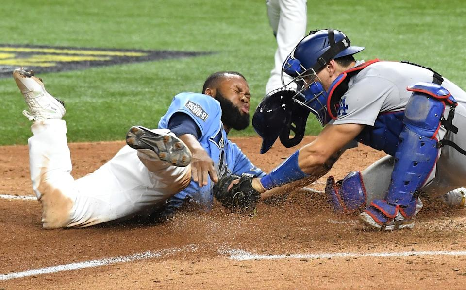 Dodgers catcher Austin Barnes tags out Rays' Manuel Margot, who was attempting to steal home during the fourth inning.