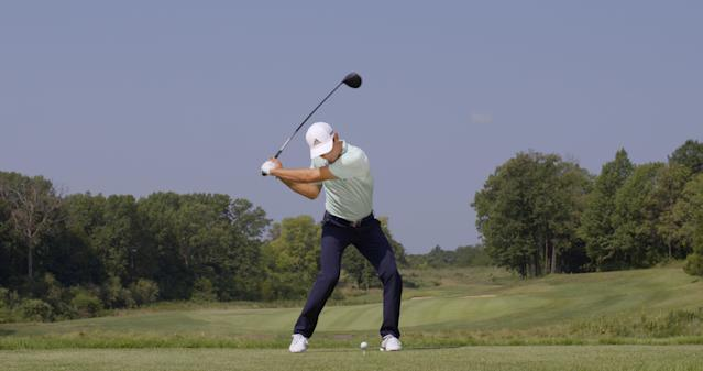 "<p><strong>DOWN AND UP</strong></p> <p>""It's amazing that at impact, his right shoulder has dropped significantly while his left leg is straightening,"" McLean says. ""Not many golfers can do that. This is where his athleticism shines."" The move allows him to simultaneously compress the ball while hitting it off the tee on the upswing.</p>"