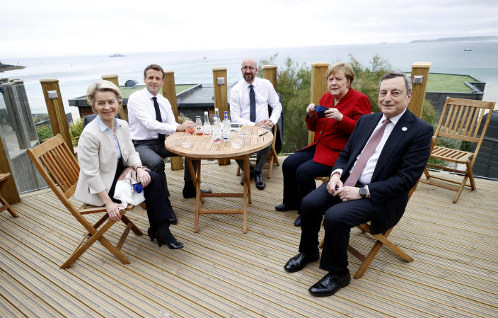 From left, European Commission President Ursula von der Leyen, French President Emmanuel Macron, European Council President Charles Michel, German Chancellor Angela Merkel and Italy's Prime Minister Mario Draghi gather for an EU coordination meeting prior to the G7 meeting at the Carbis Bay Hotel in Carbis Bay, St. Ives, Cornwall, England, Friday, June 11, 2021. Leaders of the G7 begin their first of three days of meetings on Friday, in which they will discuss COVID-19, climate, foreign policy and the economy. (Phil Noble, Pool via AP)
