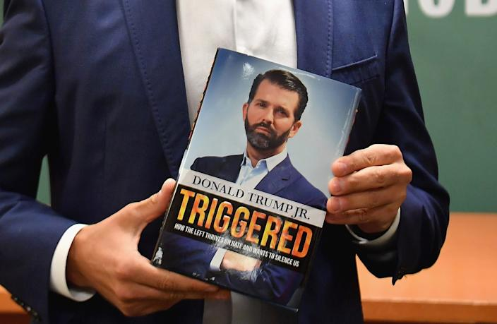 Donald Trump Jr., holds his new Book