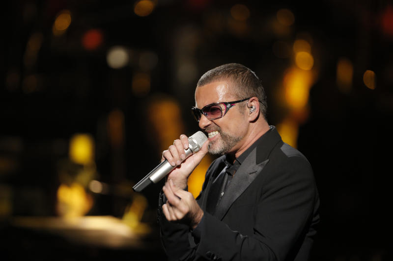 """FILE - In this Sept. 9, 2012 file photo, British singer George Michael performs at a concert to raise money for AIDS charity Sidaction, during the Symphonica tour at Palais Garnier Opera house in Paris, France. George Michael's publicist says the singer is being treated for minor injuries after he was a passenger in a car crash. A statement released Friday May 17, 2013 said he was in the accident on Thursday night and suffered """"superficial cuts and bruises."""" (AP Photo/Francois Mori, File)"""