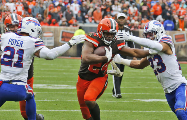 Cleveland Browns running back Nick Chubb (24) rushes between Buffalo Bills free safety Jordan Poyer (21) and strong safety Micah Hyde (23) during the first half of an NFL football game, Sunday, Nov. 10, 2019, in Cleveland. (AP Photo/Ron Schwane)