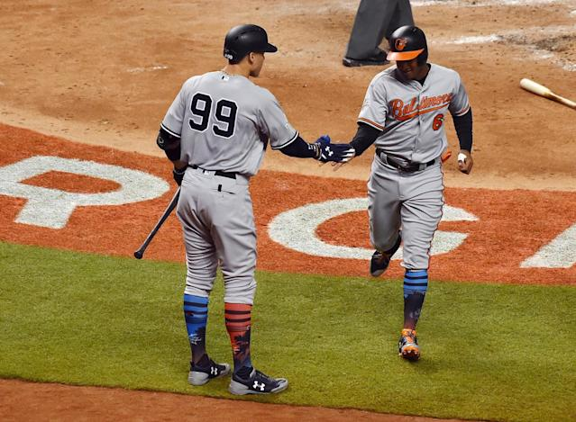 <p>American League infielder Jonathan Schoop (6) of the Baltimore Orioles celebrates with outfielder Aaron Judge (99) of the New York Yankees after scoring a run in the fifth inning during the 2017 MLB All-Star Game at Marlins Park. (Jasen Vinlove-USA TODAY Sports) </p>