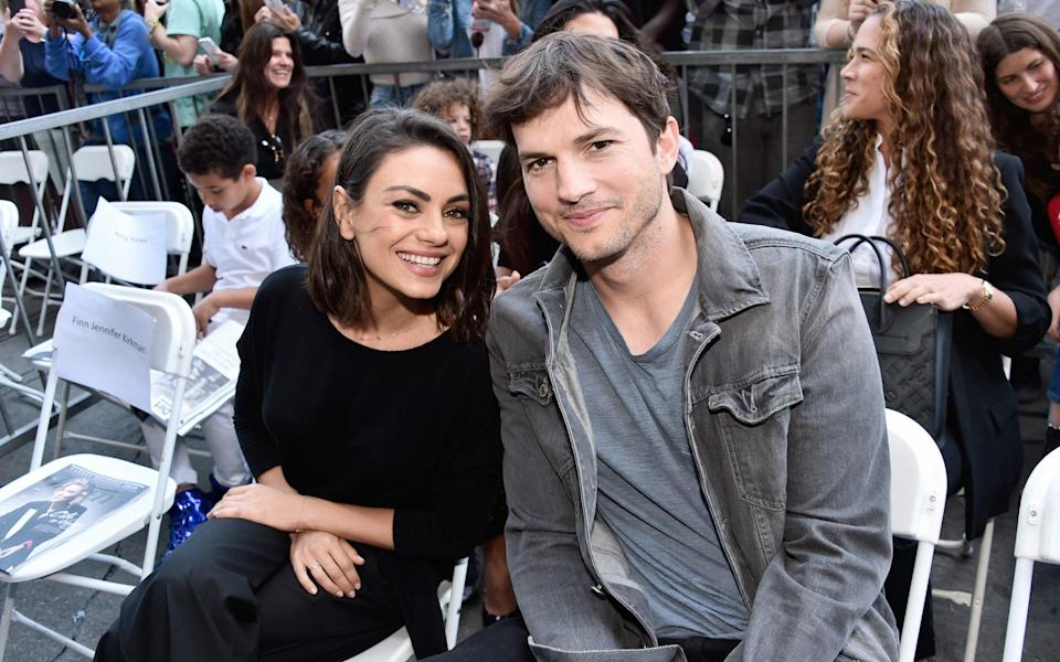 Mila Kunis and Ashton Kutcher are flying the flag for a laidback attitude to family cleanliness - Alberto E. Rodriguez/Getty Images for Disney