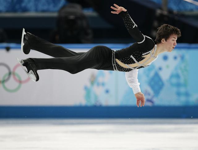 Yakov Godorozha of Ukraine competes in the men's short program figure skating competition at the Iceberg Skating Palace during the 2014 Winter Olympics, Thursday, Feb. 13, 2014, in Sochi, Russia. (AP Photo/Ivan Sekretarev)