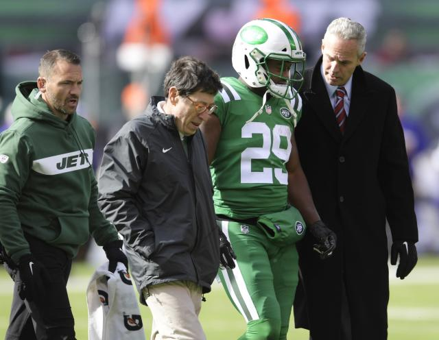 New York Jets running back Bilal Powell (29) is helped off the field after being hurt during the first half of an NFL football game against the Minnesota Vikings Sunday, Oct. 21, 2018, in East Rutherford, N.J. (AP Photo/Bill Kostroun)