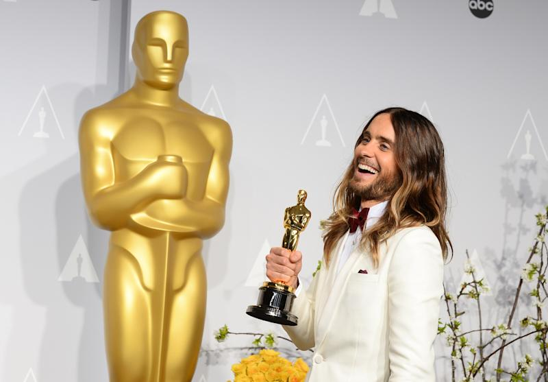 """FILE - In this March 2, 2014 file photo, Jared Leto poses in the press room with the award for best actor in a supporting role for """"Dallas Buyers Club"""" during the Oscars at the Dolby Theatre in Los Angeles. Leto is now promoting """"Artifact,"""" a documentary he directed about his band 30 Seconds to Mars' battle with its record label over its contract and a $30 million lawsuit. The film, available now on iTunes, airs April 26, 2014 on VH1 and Palladia. (Photo by Jordan Strauss/Invision/AP, file)"""
