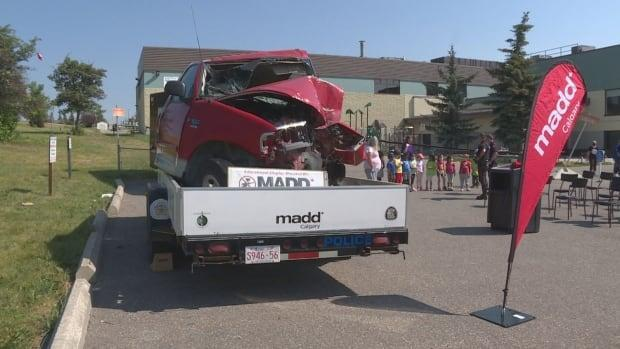 Mothers Against Drunk Driving launches a crashed car campaign in Calgary ahead of Stampede and as restrictions are lifted. (Axel Tardieu/CBC - image credit)
