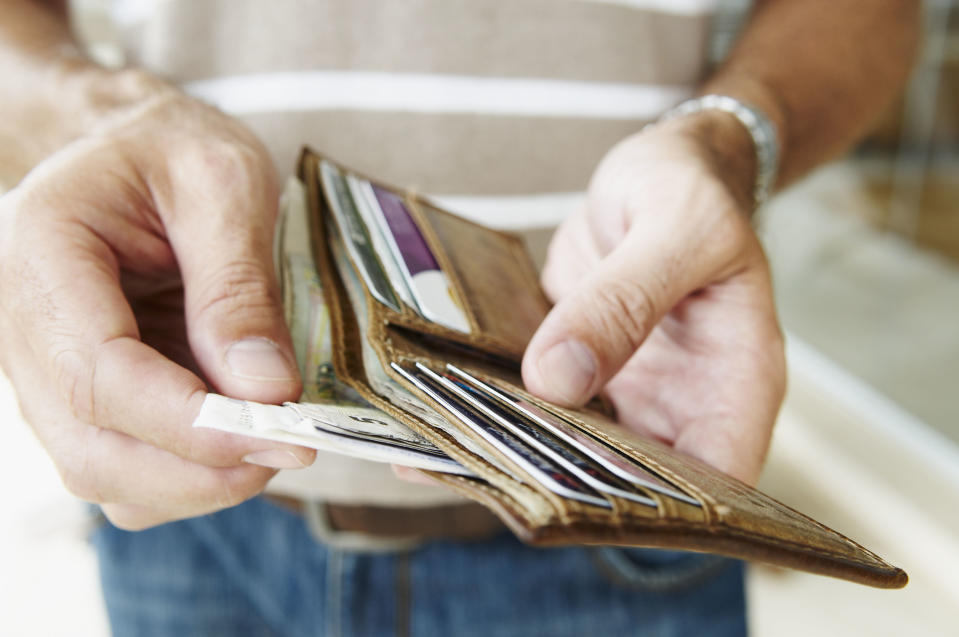 Man removes cash from wallet