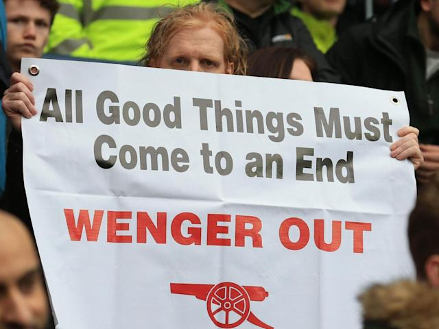 Several fans revealed anti-Wenger banners (Getty)
