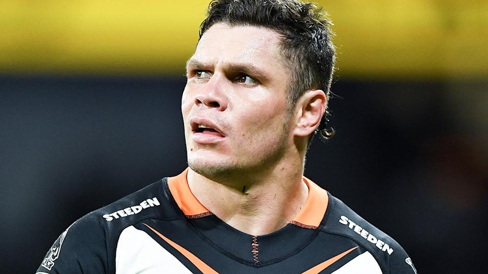 Wests Tigers' James Roberts ventured out onto the balcony of his room in hotel quarantine, against Queensland government rules.