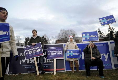 Supporters of U.S. Democratic presidential candidates Sanders and Clinton rally before the Democratic presidential candidates debate at Saint Anselm College in Manchester