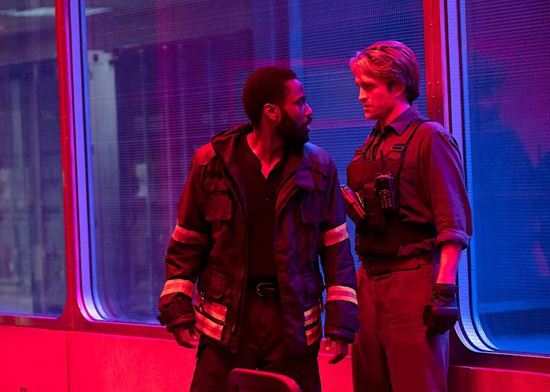 John David Washington and Robert Pattinson debate when Tenet will be released in cinemas (Image by Warner Bros)