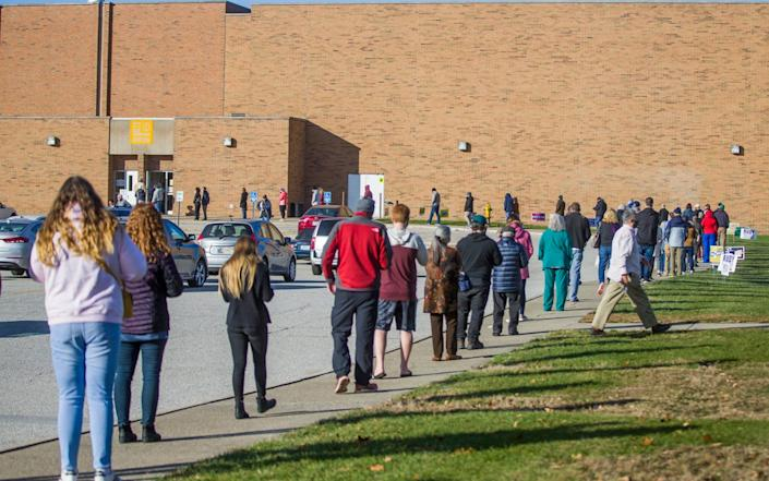 People line up to cast their ballots in South Bend, Indiana - Robert Franklin /South Bend Tribune