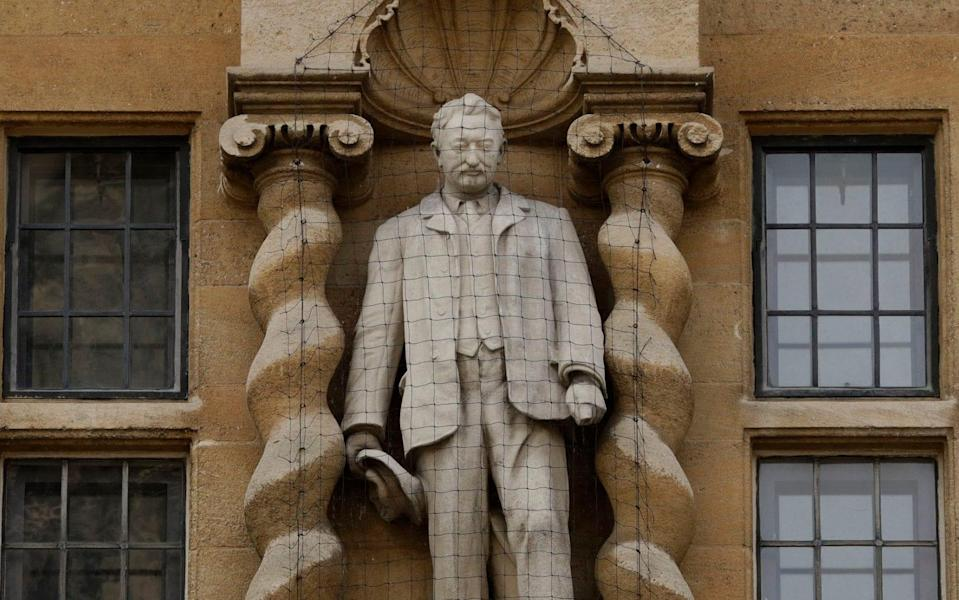 """259136533 / 728db9e0-ffed-3919-86c4-eb3ddacd80a6 Image headline: Cecil Rhodes statue Original description: FILE - In this Wednesday, June 17, 2020 file photo, a view of the statue of Cecil Rhodes, the Victorian imperialist who supported apartheid-style measures in southern Africa stands mounted on the facade of Oriel College in Oxford, England. The controversial statue of Victorian imperialist Cecil Rhodes will not be taken down because of """"regulatory and financial challenges,"""" the governing body of Oxford University's Oriel College said Thursday, May 20, 2021. The decision follows a long-running campaign to remove the statue of a man who made a fortune in the late 19th century from gold and diamond mines where miners labored in brutal conditions. (AP Photo/Matt Dunham, File) Image title: Britain Rhodes Statue Credit: Matt Dunham Source: AP Filename: TELEMMGLPICT000259136533.jpeg"""