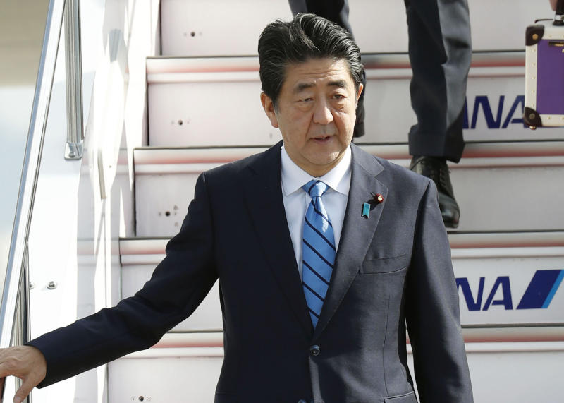 Japanese Prime Minister Shinzo Abe arrives at Haneda airport in Tokyo Friday morning, June 14, 2019 after a two-day visit to Iran.  A Japanese-owned oil tanker was attacked near the Strait of Hormuz on Thursday. (Naoya Osato/Kyodo News via AP)