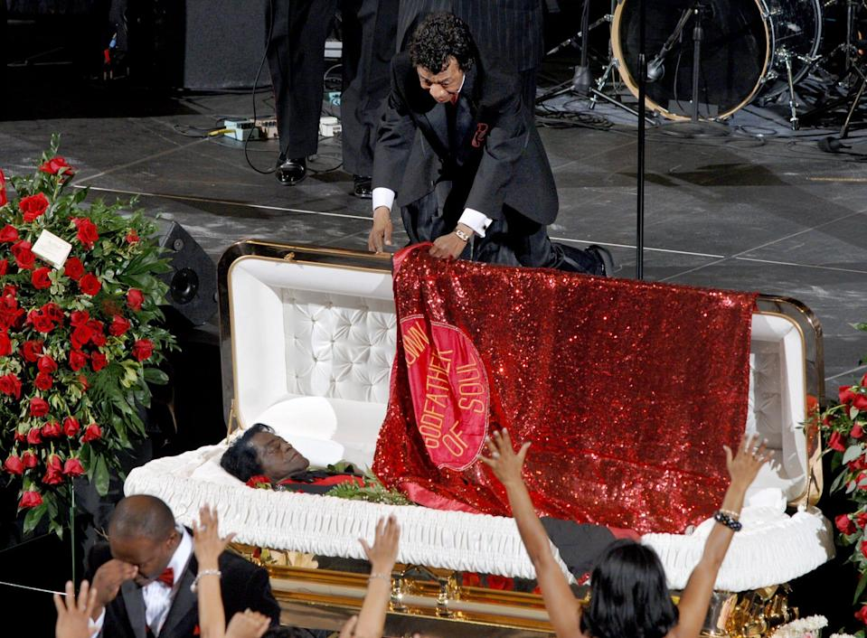Danny Ray puts the cape on James Brown one last time December 30, 2006 at James Brown Arena during Brown's funeral. Ray died Tuesday.