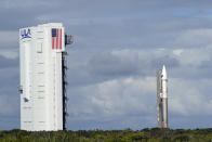 United Launch Alliance Atlas V rocket with the Lucy spacecraft aboard is rolled out of the Vertical Integration Facility to the launch pad at Space Launch Complex 41 at the Cape Canaveral Space Force Station, Thursday, Oct. 14, 2021, in Cape Canaveral, Fla. The robotic trailblazer named Lucy is slated to blast off on Saturday on a 12-year cruise to unexplored swarms of asteroids out near Jupiter.. (AP Photo/John Raoux)