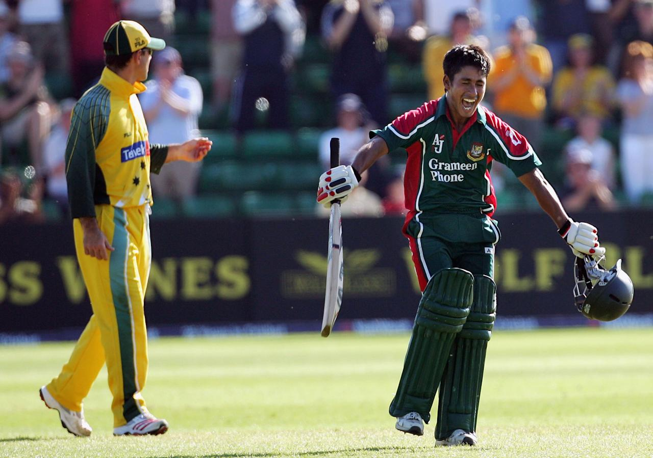 Mohammad Ashraful of Bangladesh celebrates his century with Ricky Ponting of Australia looking on during the NatWest Series One Day International between Australia and Bangladesh played at Sophia Gardens on June 18, 2005 in Cardiff, United Kingdom  (Photo by Hamish Blair/Getty Images)