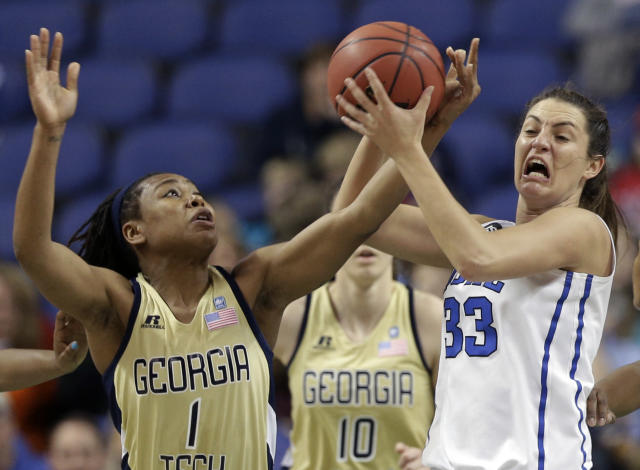 Duke's Haley Peters (33) is fouled by Georgia Tech's Dawnn Maye (1) during the first half of an NCAA college basketball game at the Atlantic Coast Conference tournament in Greensboro, N.C., Friday, March 7, 2014. (AP Photo/Chuck Burton)