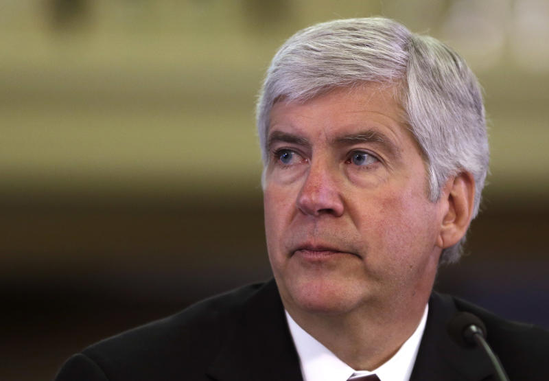 FILE - In this Feb. 7, 2013 file photo, Michigan Gov. Rick Snyder presents his third state budget before the state Legislature in Lansing, Mich. Snyder is taking questions under oath as labor unions and other creditors in Detroit's bankruptcy try to understand why he signed off on the largest public filing in U.S. history. Three months later, no assets have been divided and no major deals have been struck. In fact, a judge soon will hold a trial to determine if Detroit even is eligible to be in Bankruptcy Court to restructure at least $18 billion in long-term debt. Snyder's answers during a three-hour deposition Wednesday, Oct. 9, 2013, can be turned into evidence at the trial. (AP Photo/Carlos Osorio)