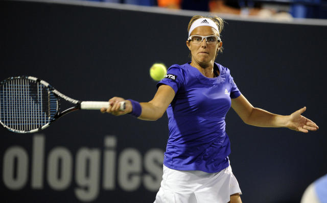 Kirsten Flipkens, of Belgium, hits a forehand during a quarterfinal match against Samantha Stosur, of Australia, at the New Haven Open tennis tournament in New Haven, Conn., on Thursday, Aug. 21, 2014. (AP Photo/Fred Beckham)