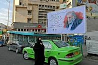 "Fakhrizadeh, shown here on a billboard in the capital, did not have a high profile before he was killed, but is now being celebrated as a top ""martyr"" by the Islamic republic"