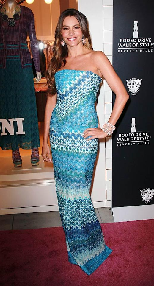 "This year's Walk of Style Awards was star-studded, but one celeb stole the spotlight. Hot ""Modern Family"" mama Sofia Vergara stood out at the soiree in a strapless Missoni stunner, diamond-and-coral cuff, and her signature smile. (10/23/2011)"