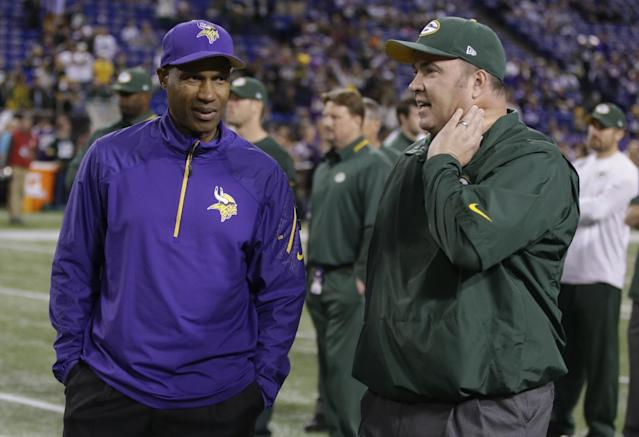 Minnesota Vikings head coach Leslie Frazier talks to Green Bay Packers head coach Mike McCarthy before an NFL football game, Sunday, Oct. 27, 2013, in Minneapolis. (AP Photo/Jim Mone)