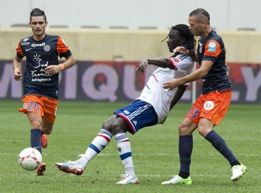Lyon's Bafetimbi Gomis (C) plays against Montpellier Jamel Saihi (R) and Remy Cabella during the 2012 edition of the Champions Trophy at Red Bull Arena in Harrison, New Jersey. French Cup holders Lyon kicked off the new season by beating title-holders Montpellier on penalties to win the Champions Trophy