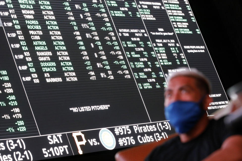 Sports betting is increasingly becoming legalized in states across the U.S. (AP Photo/John Locher)