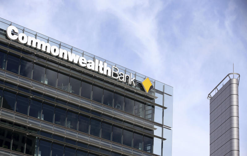 The Commonwealth Bank branding is displayed on its headquarters in Sydney, Wednesday, Feb. 6, 2019. The Commonwealth Bank of Australia recorded a drop in statutory net profit in its latest half-year to 4.6 billion Australian dollars ($3.3 billion) as the nation's biggest lender was hit by costs for misconduct as well as lower profit margins and a downturn in the housing market. (AP Photo/Rick Rycroft)