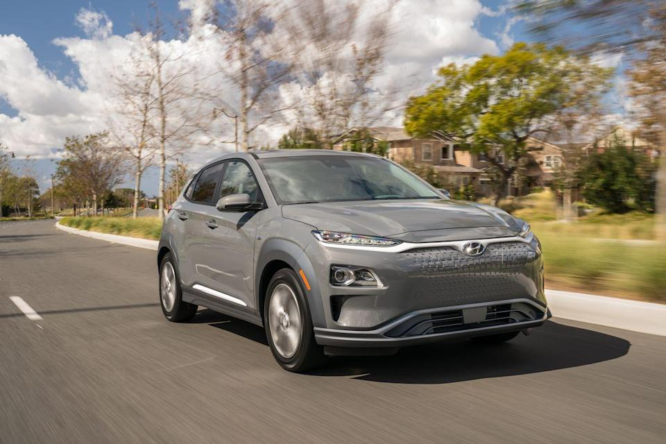 """<p>To compete with the growing number of electric vehicles hitting the market, <a href=""""https://www.caranddriver.com/hyundai"""" rel=""""nofollow noopener"""" target=""""_blank"""" data-ylk=""""slk:Hyundai"""" class=""""link rapid-noclick-resp"""">Hyundai</a> has swapped the <a href=""""https://www.caranddriver.com/hyundai/kona"""" rel=""""nofollow noopener"""" target=""""_blank"""" data-ylk=""""slk:Kona SUV's"""" class=""""link rapid-noclick-resp"""">Kona SUV's</a> gasoline engine for an electric motor and battery pack to create the <a href=""""https://www.caranddriver.com/hyundai/kona-electric"""" rel=""""nofollow noopener"""" target=""""_blank"""" data-ylk=""""slk:2021 Kona Electric"""" class=""""link rapid-noclick-resp"""">2021 Kona Electric</a>. The swap has resulted in a compelling electric vehicle, with an engaging driving character, zippy performance, and up to 258 miles of all-electric driving range. Styling differences include a unique grille and wheels, but the Kona Electric's unique looks still turns heads like the regular version. Rival EVs such as the <a href=""""https://www.caranddriver.com/chevrolet/bolt-ev"""" rel=""""nofollow noopener"""" target=""""_blank"""" data-ylk=""""slk:Chevrolet Bolt"""" class=""""link rapid-noclick-resp"""">Chevrolet Bolt</a>, the <a href=""""https://www.caranddriver.com/tesla/model-3"""" rel=""""nofollow noopener"""" target=""""_blank"""" data-ylk=""""slk:Tesla Model 3"""" class=""""link rapid-noclick-resp"""">Tesla Model 3</a>, and <a href=""""https://www.caranddriver.com/kia/niro-ev"""" rel=""""nofollow noopener"""" target=""""_blank"""" data-ylk=""""slk:Kia Niro EV"""" class=""""link rapid-noclick-resp"""">Kia Niro EV</a> offer similar functionality, but the Hyundai's starting price and unbeatable warranty makes it one of the smarter choices in the segment.</p><p><a class=""""link rapid-noclick-resp"""" href=""""https://www.caranddriver.com/hyundai/kona-electric"""" rel=""""nofollow noopener"""" target=""""_blank"""" data-ylk=""""slk:Review, Pricing, and Specs"""">Review, Pricing, and Specs</a></p>"""
