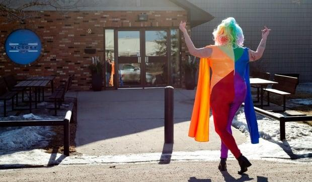 Terry Van Mackelberg, also known as Flo Mingo, danced in front of Victory Church on Sunday during a rally to show support for the LGBTQ community in Regina.