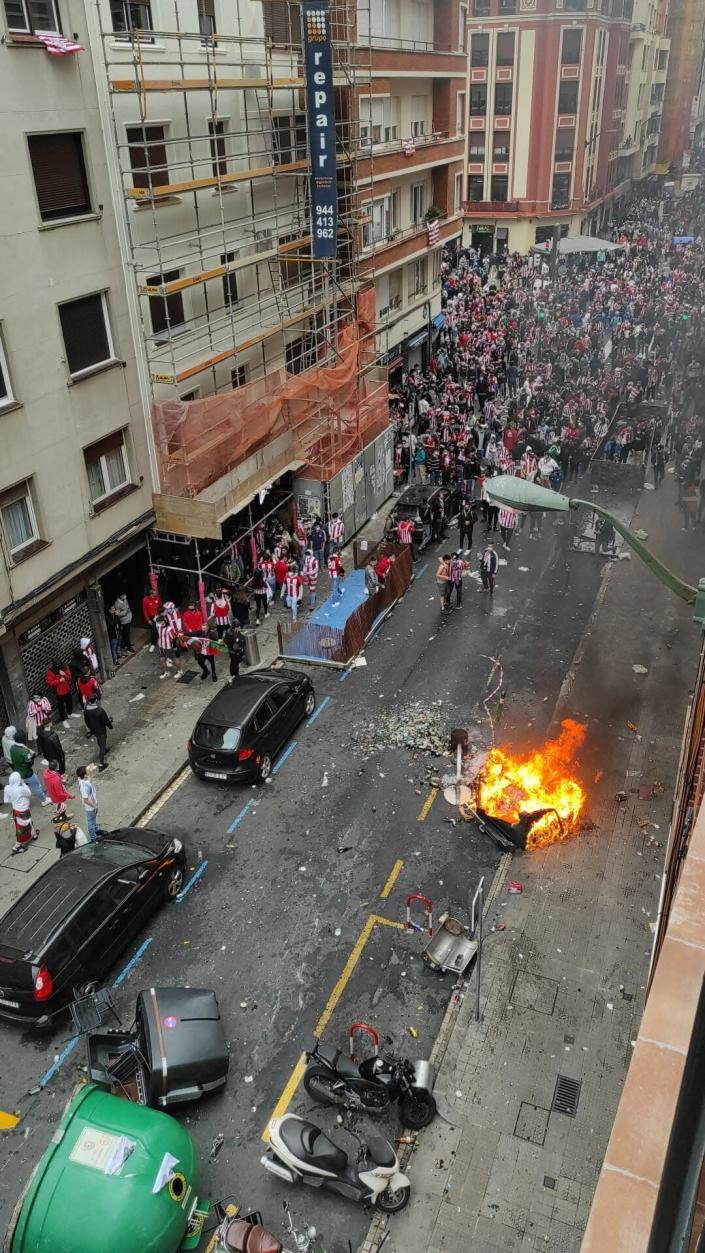 Athletic Bilbao soccer supporters gather in the street in Bilbao, northern Spain, Saturday, April 3, 2021. A few thousand Bilbao fans violated public health restrictions in place for the coronavirus pandemic on Saturday when they rallied in rowdy groups. Authorities in Spain's Basque Country region are calling on fans of Athletic Bilbao to break up street gatherings that have formed ahead of their team's Copa del Rey final against fierce rival Real Sociedad. (Europa Press via AP)