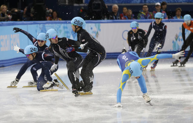 From left, Lee Ho-suk of South Korea, Park Se Yeong of South Korea, Eduardo Alvarez of the United States, and J.R. Celski of the United States struggle to keep their balance as they compete in a men's 5000m short track speedskating relay semifinal at the Iceberg Skating Palace during the 2014 Winter Olympics, Thursday, Feb. 13, 2014, in Sochi, Russia. (AP Photo/David Goldman)