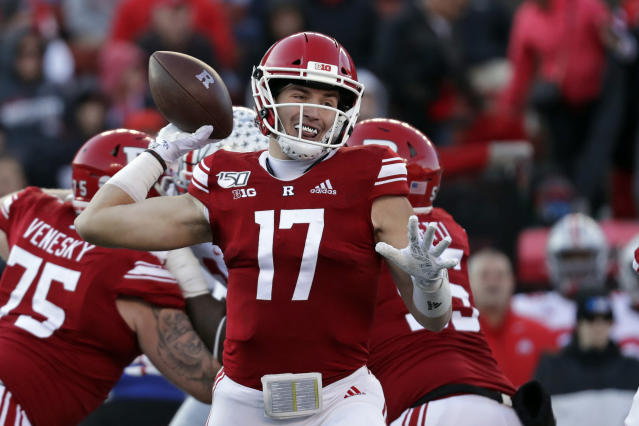 Rutgers quarterback Johnny Langan passes during the first half of an NCAA college football game against Ohio State on Saturday, Nov. 16, 2019, in Piscataway, N.J. (AP Photo/Adam Hunger)
