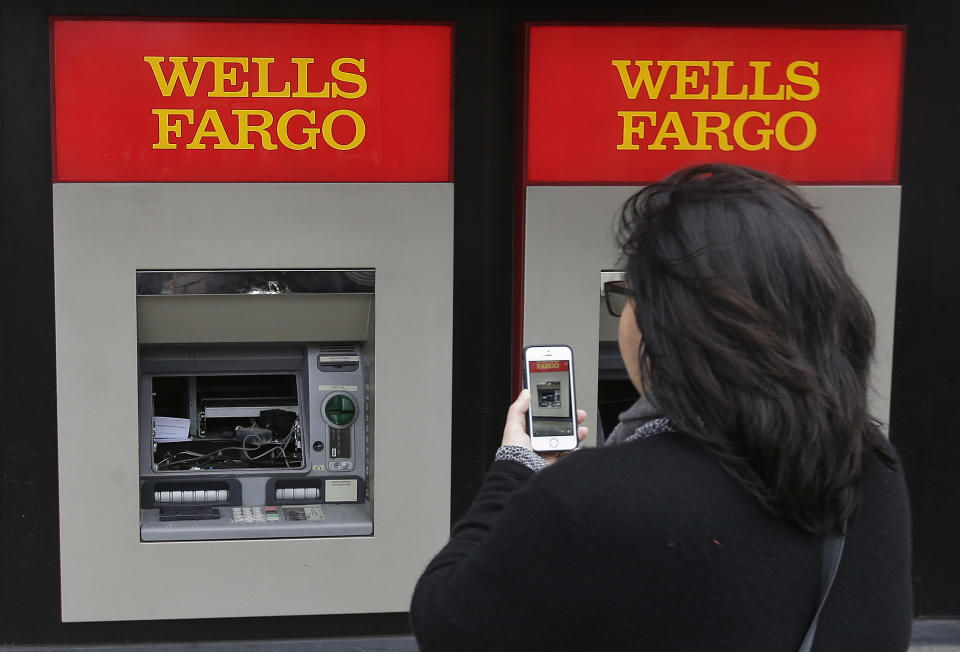 Consumer anger that resulted in this smashed ATM was tempered by the CFPB's $100 million fine against Wells Fargo. Source: AP
