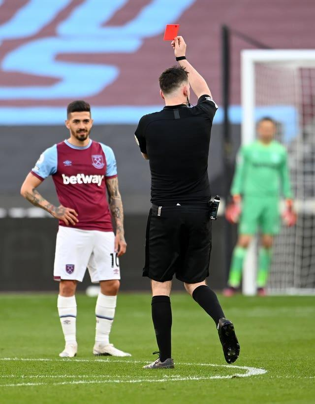 West Ham's Fabian Balbuena is controversially shown a red card by referee Chris Kavanagh after catching Ben Chilwell in his follow-through as he cleared the ball