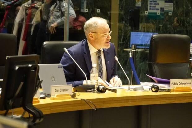 Ottawa International Airport CEO Mark Laroche addresses a special meeting of city council in February 2019 about the contracts to build Stage 2 of LRT.