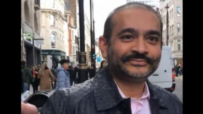 A UK court has issued a warrant to arrest fugitive diamantaire Nirav Modi, who was recently spotted roaming around in London.