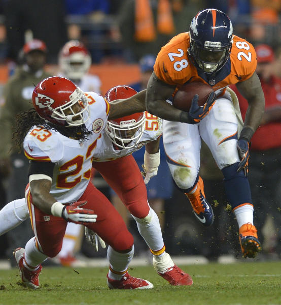 Denver Broncos running back Montee Ball (28) leaps to avoid Kansas City Chiefs free safety Kendrick Lewis (23) in the fourth quarter of an NFL football game, Sunday, Nov. 17, 2013, in Denver. (AP Photo/Jack Dempsey)