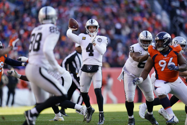Oakland Raiders quarterback Derek Carr, center, throws a pass during the first half of an NFL football game against the Denver Broncos, Sunday, Dec. 29, 2019, in Denver. (AP Photo/Jack Dempsey)