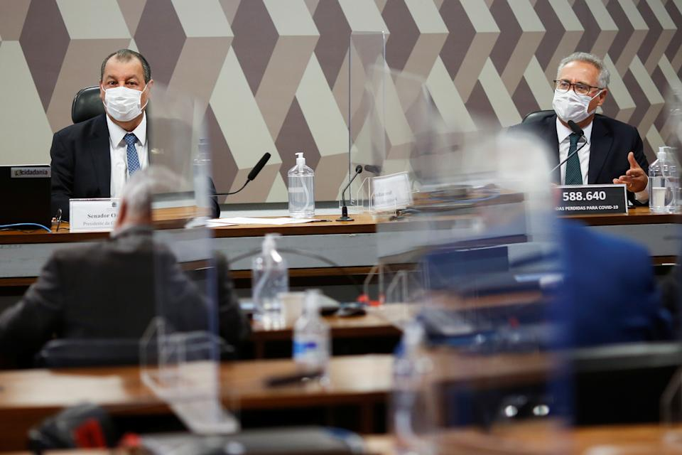 Brazilian Senator Omar Aziz and Senator Renan Calheiros attend a meeting of the Parliamentary Inquiry Committee (CPI) to investigate government actions and management during the coronavirus disease (COVID-19) pandemic, at the Federal Senate in Brasilia, Brazil, September 16, 2021. REUTERS/Adriano Machado