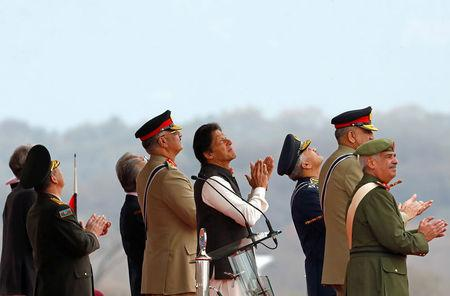 Pakistani PM Imran Khan observes the fly-past during the Pakistan Day military parade in Islamabad