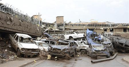 Dozen of cars piled up on top of each other in the parking lot of Moore Hospital after a tornado struck Moore, Oklahoma in this file photo from May 20, 2013. REUTERS/Gene Blevins/Files