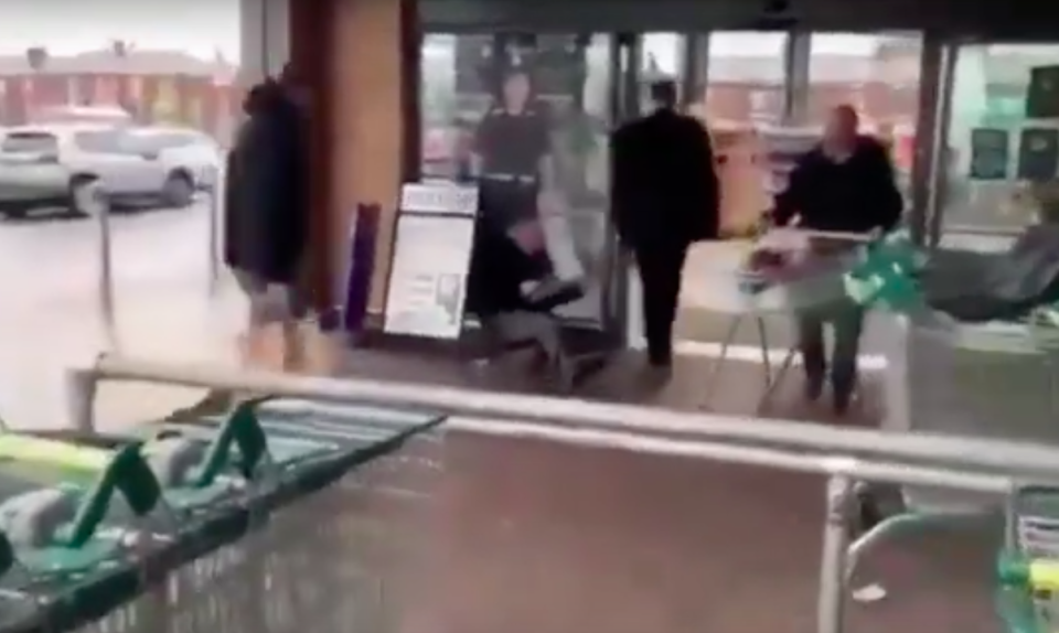 The campaigner was filmed being forced to the floor by security (YouTube)